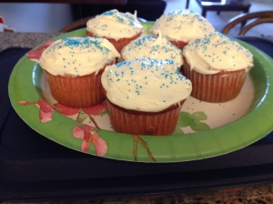 Strawberry cupcakes with vanilla frosting and blue sprinkles...patriotic, right?