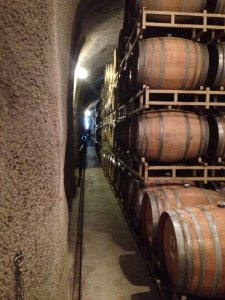Barrels full of wine in the caves at Rutherford Hill