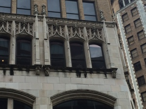 "Faces and gargoyles on the ""unlucky"" building"
